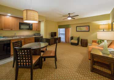 Dining area and view of living room in a one bedroom villa in West Village at Orange Lake Resort near Orlando, FL
