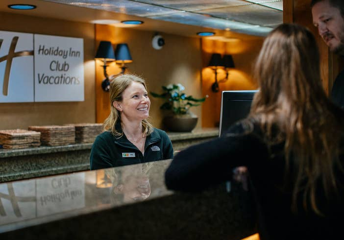 Two adults checking into Tahoe Ridge Resort in Stateline, Nevada.