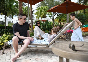 Family relaxing in sun chairs at Orange Lake Resort near Orlando, Florida