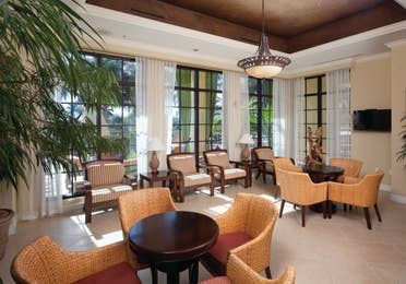 Lounge with comfortable seating and flat screen TV at Sunset Cove Resort