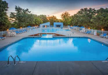 Outdoor pool with sun chairs at Ozark Mountain Resort in Kimberling City, Missouri