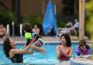 Family enjoying outdoor pool.