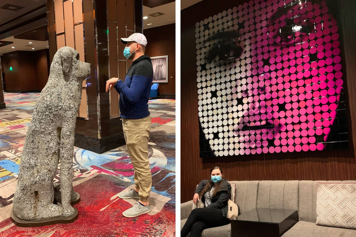 Left: Featured Contributor, Ashley Fraboni's fiancé, Nicholas, poses in front of a dog statue at the Cosmopolitan of Las Vegas. Right: Ashley sits under a pop-art mural at the Cosmopolitan of Las Vegas.