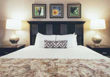 Bed with two night stands in a two bedroom villa in West Village at Orange Lake Resort near Orlando, FL