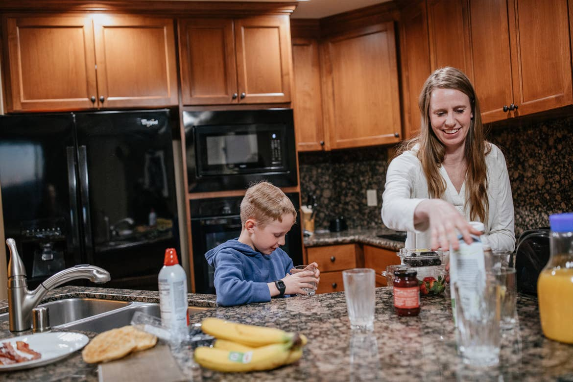 Andrea Rassmussen and her family prep some smoothies in the kitchen