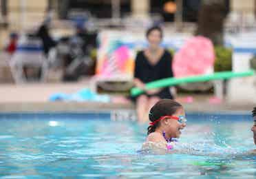 Young girl enjoying the pool at Orange Lake Resort near Orlando, Florida