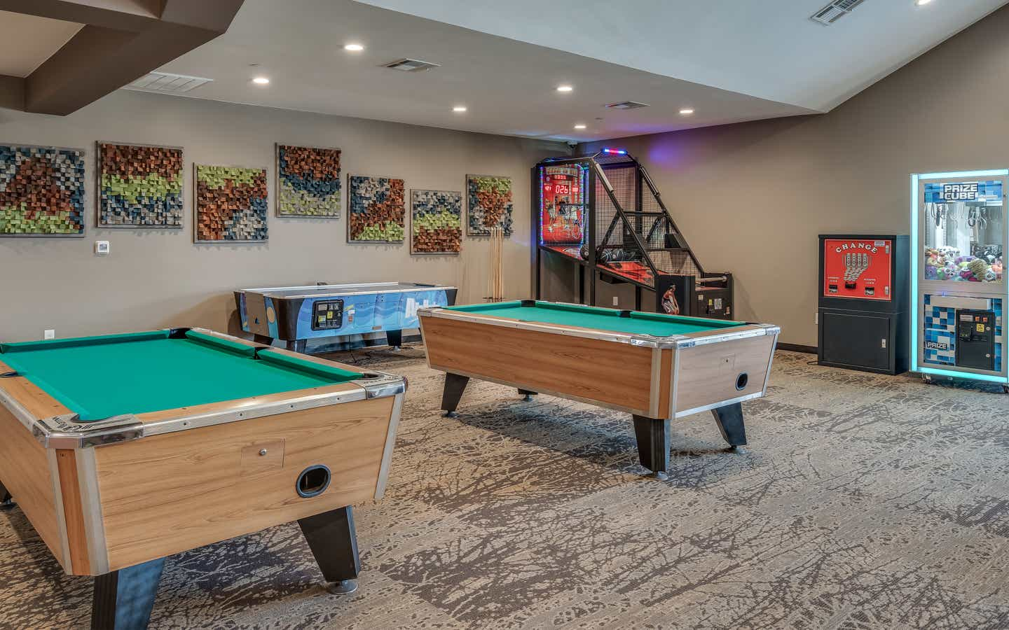 Game room with pool tables and air hockey at Piney Shores Resort in Conroe, Texas.