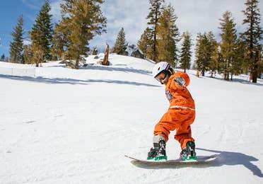 Children snowboarding at the activity center near Lake Geneva Resort, Lake Geneva, WI.
