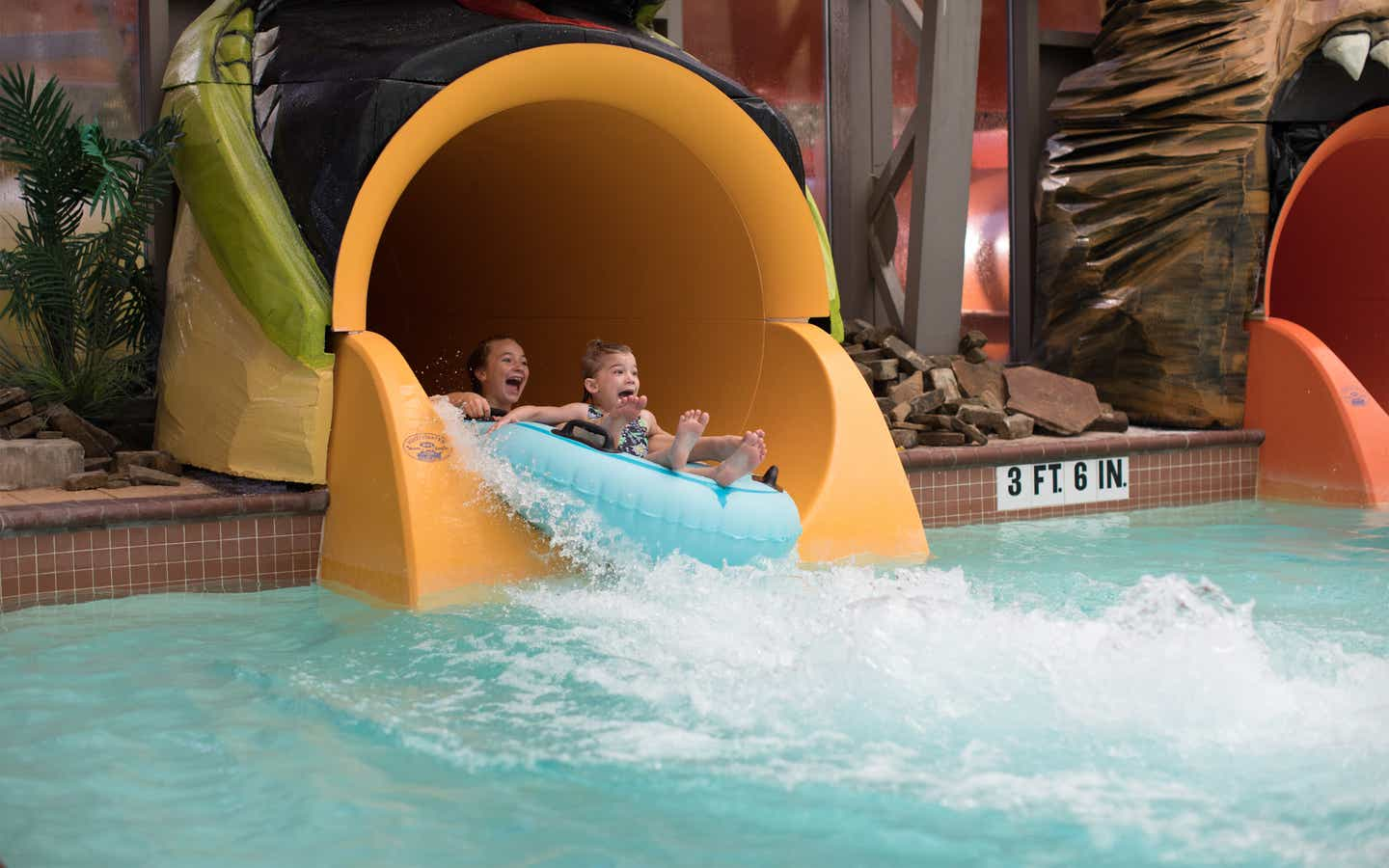 Two children sliding down waterslide at The Waterpark at The Villages at Villages Resort in Flint, Texas.