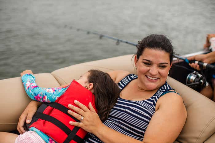Angelica cuddling with her daughter on the boat