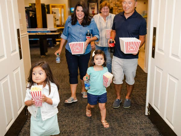 Family of five going to view a movie at Holiday Hills Resort in Branson, Missouri.