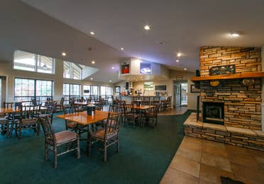 Dining area with fireplace and bar at the Holiday Hills Resort in Branson Missouri