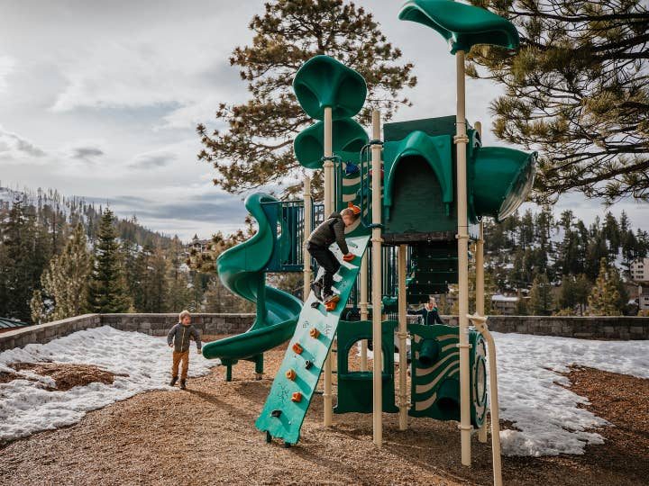 Children playing on outdoor playground at Tahoe Ridge Resort in Stateline, Nevada