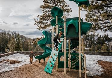 Children playing on outdoor playground at Tahoe Ridge Resort in Stateline, Nevada.
