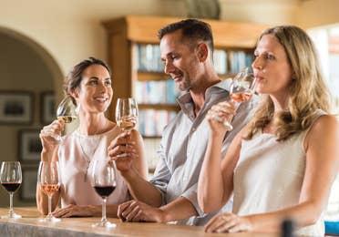 Family enjoying wine at a bar near Orange Lake Resort in Orlando, Florida