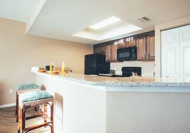 Kitchen bar with two stools in a villa in North Village at Orange Lake Resort near Orlando, Florida