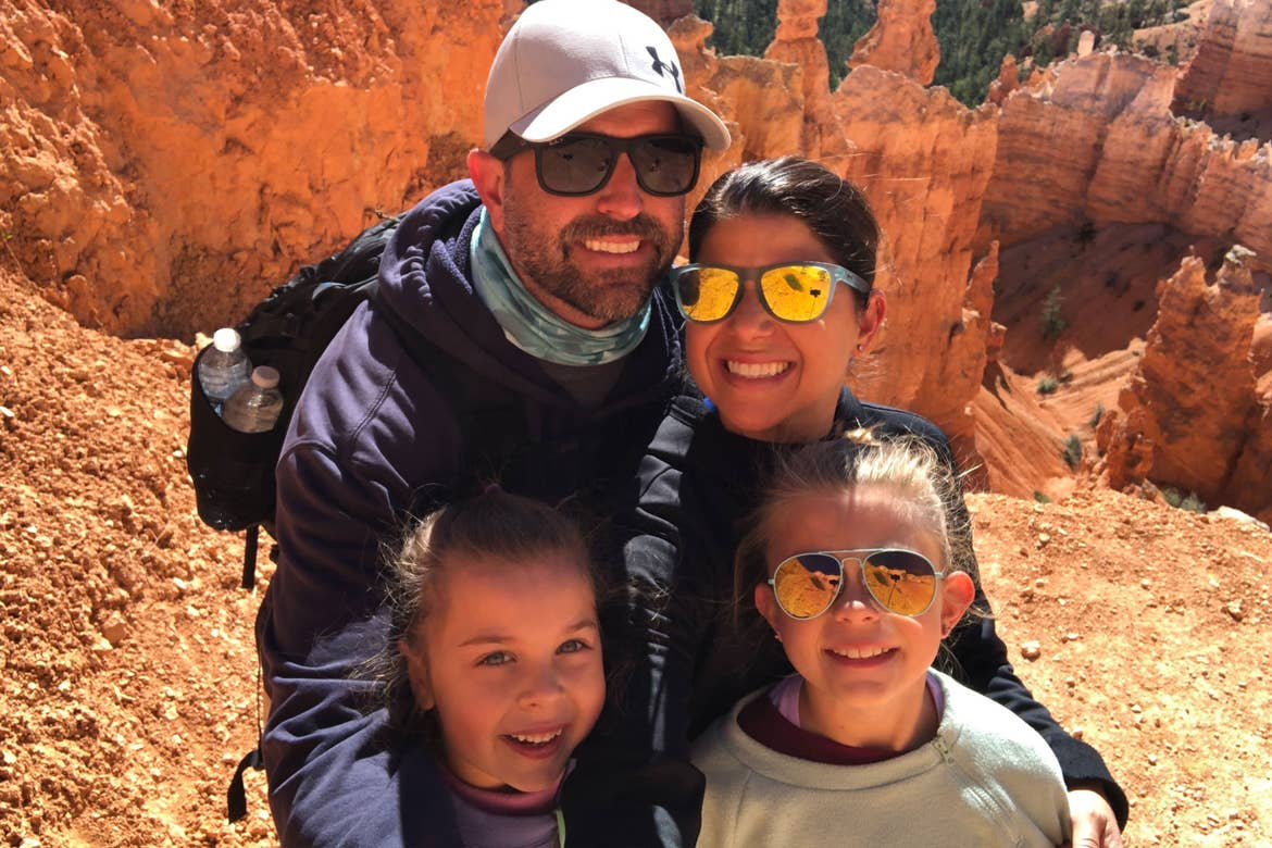 Chris (top-right) and Josh (top-left) pose with Kyndall (Bottom-right) and Kyler (bottom-left) in front of Red Rock formations from Capitol Reef National Park.