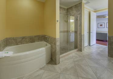 Bathroom with spa tub and walk-in shower in a presidential villa at Fox River Resort in Sheridan, Illinois