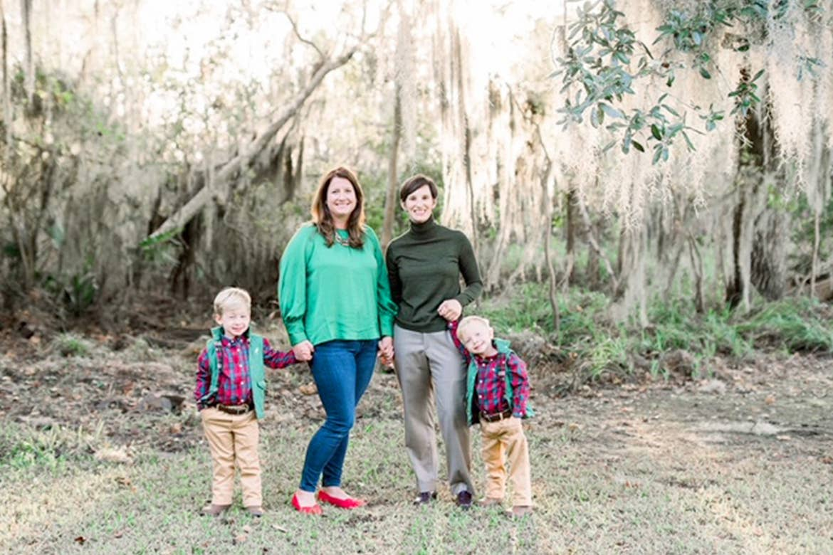 Featured Contributor, Catherine Karas (left), and her family stand outdoors.