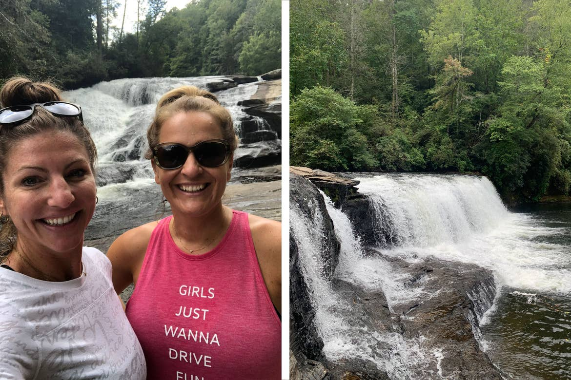 Co-author, Christine, wears a white long-sleeved shirt while posing with a friend near a waterfall.