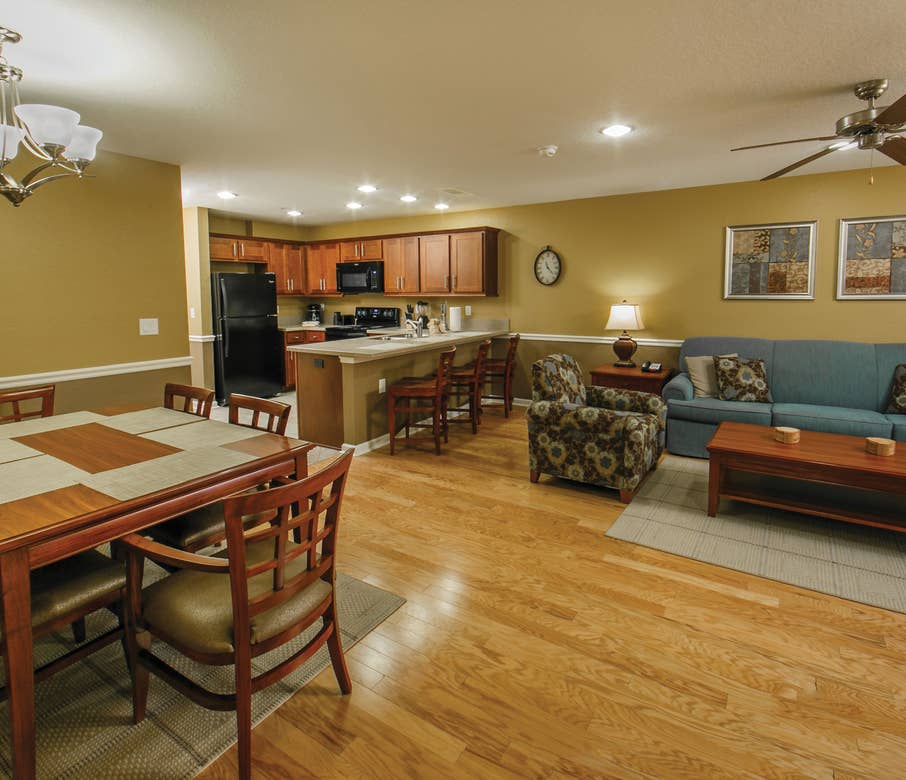 Living, kitchen and dining areas in a villa at Orlando Breeze Resort.