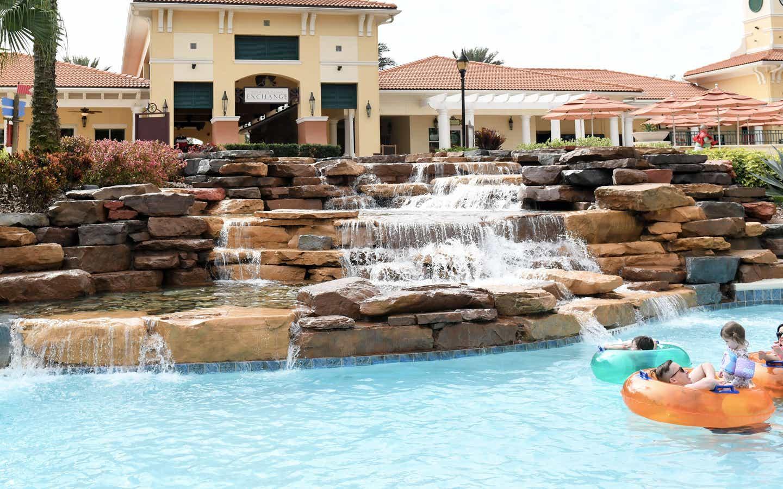 Family floating in inner tubes in the Orange Lake Resort pool in Orlando, FL