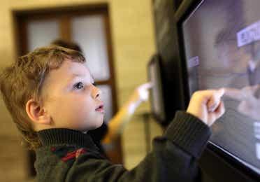 Child playing on interactive screen at Wonder Works near Panama City Beach Resort.