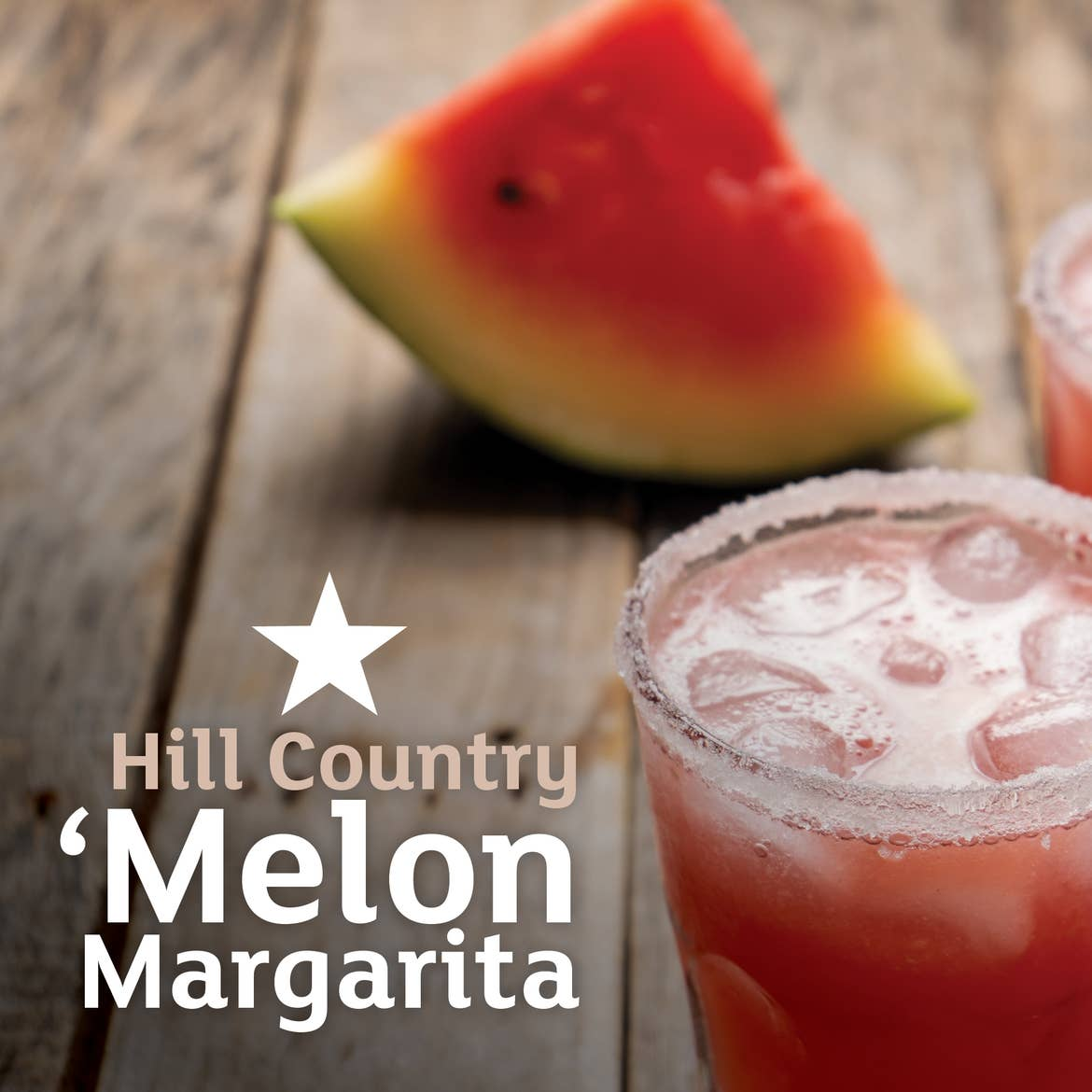 Two glasses of Melon Margaritas sit on a wooden plank table in front of a watermelon wedge. Type on the left says, 'Hill Country 'Melon Margarita.'