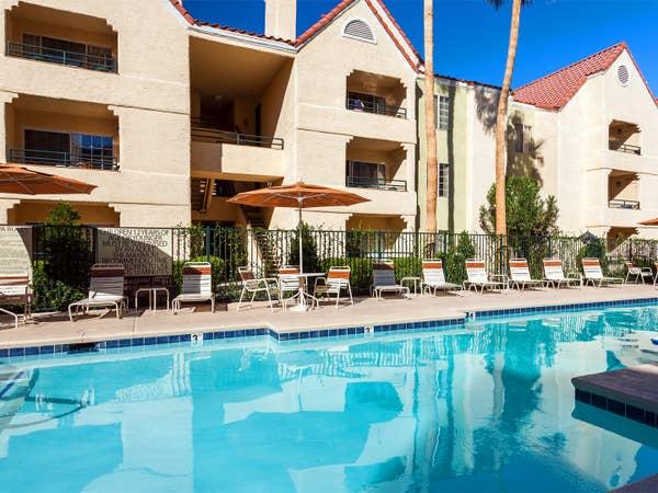 Pool with seating at Desert Club Resort.