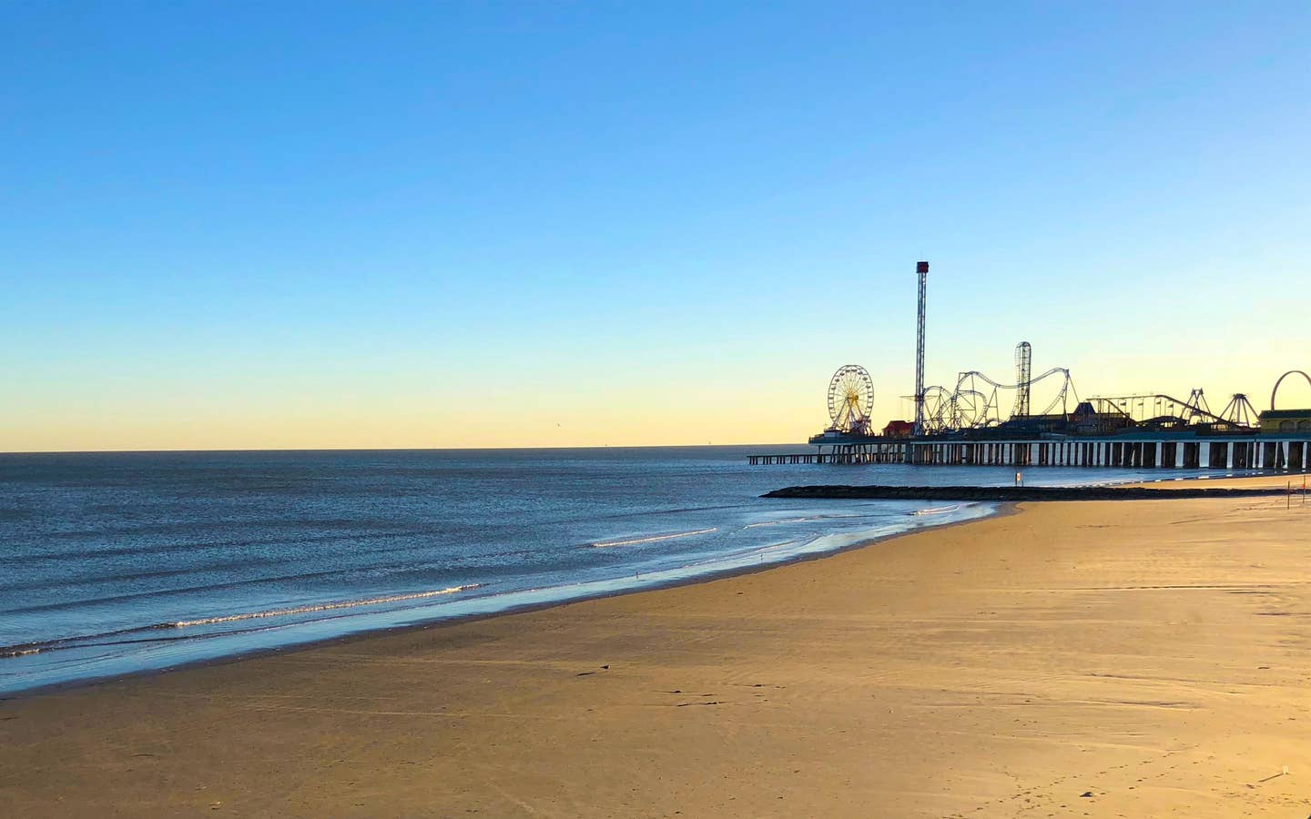 A view of Pleasure Pier near Galveston Seaside Resort.