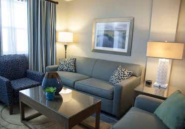 Living room with couch and two accent chairs in a villa at Panama City Beach Resort