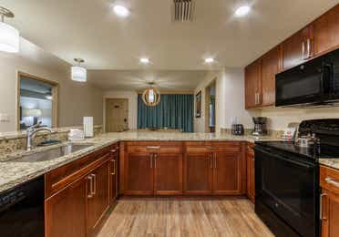 Full kitchen with dishwasher, fridge, oven, microwave, and sink in a three-bedroom villa at Scottsdale Resort