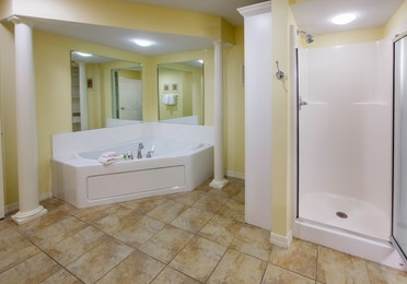 Bathroom with walk-in shower and large bathtub in a Presidential two-bedroom villa at Ozark Mountain Resort in Kimberling City, Missouri