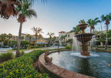 Outdoor fountain surrounded by palm trees at Cape Canaveral Beach Resort