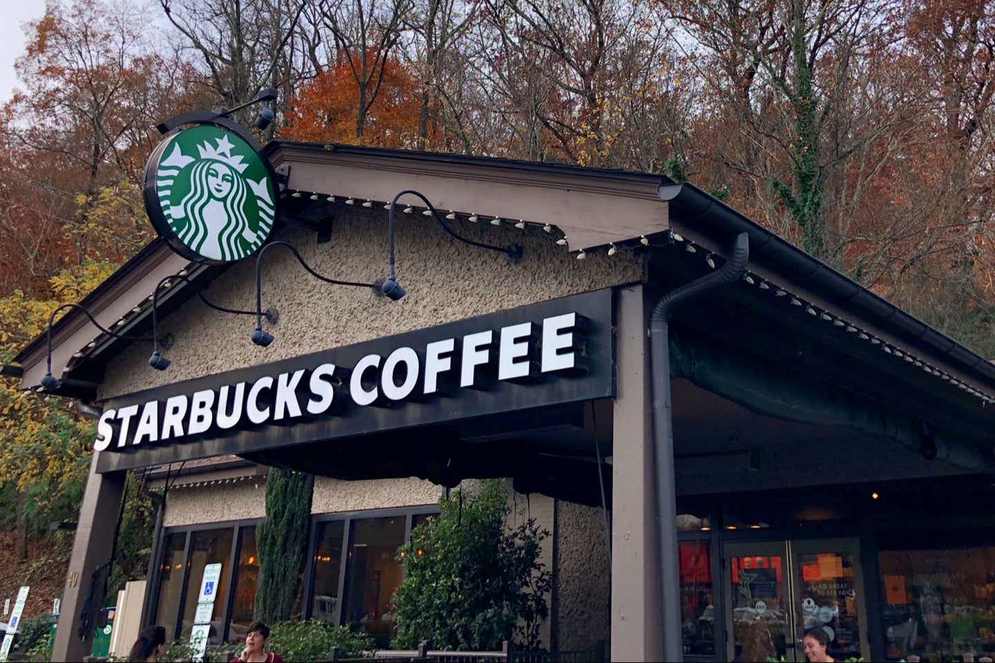 The exterior of a local Starbucks near the Biltmore Estate with signage that reads, 'Starbucks Coffee.'