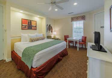 Bedroom in a two-bedroom presidential villa at Villages Resort