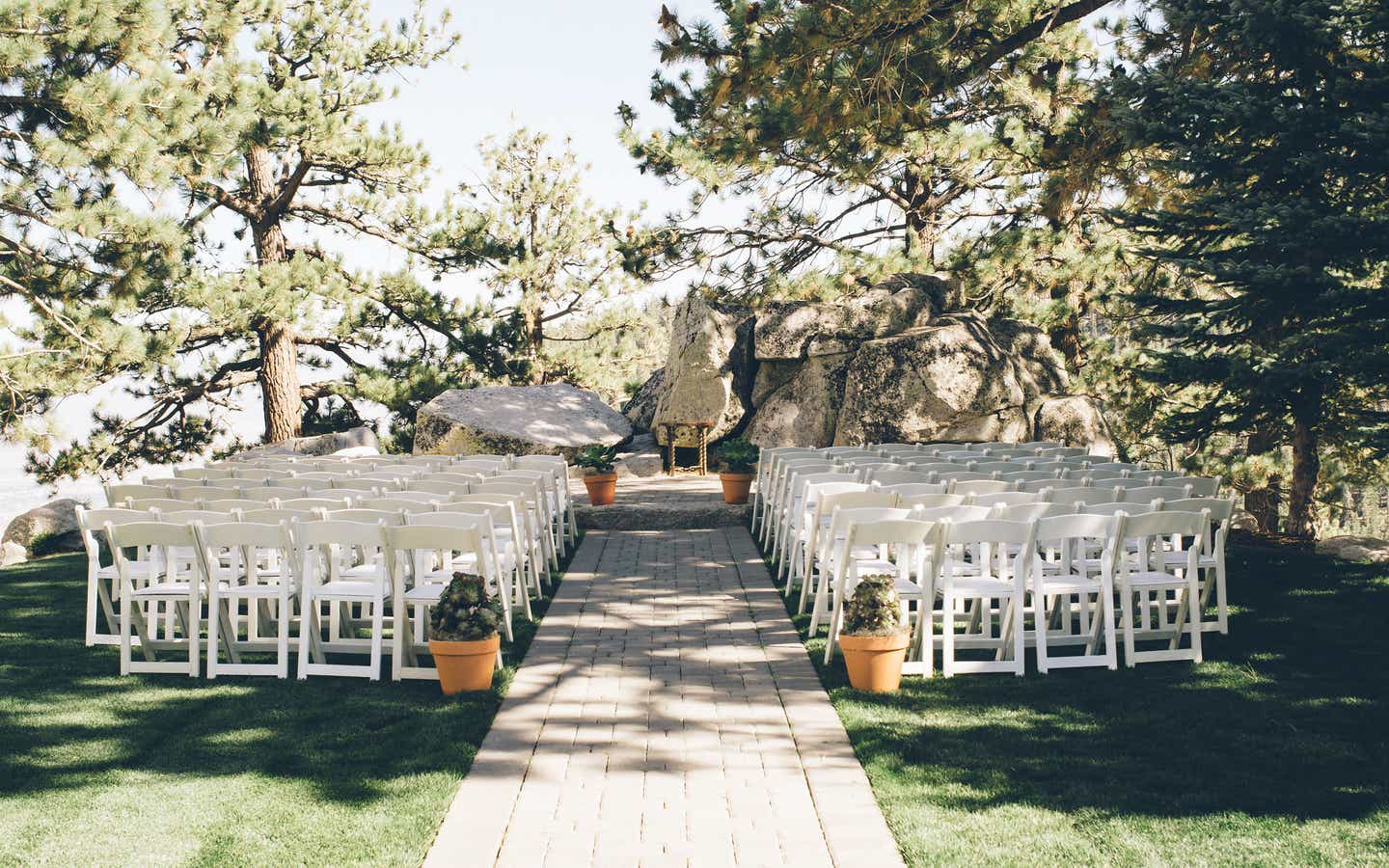 White chairs set up for a wedding ceremony