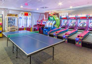 Game room with ping pong table at Oak n Spruce Resort.