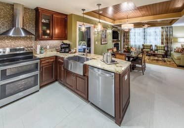 Kitchen with stainless steel appliances in a Signature Collection villa at Smoky Mountain Resort in Gatlinburg, Tennessee.