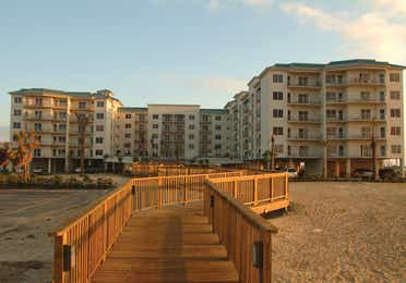 Exterior of Galveston Beach Resort at sunset