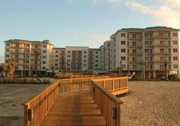 Exterior of Galveston Beach Resort at sunset