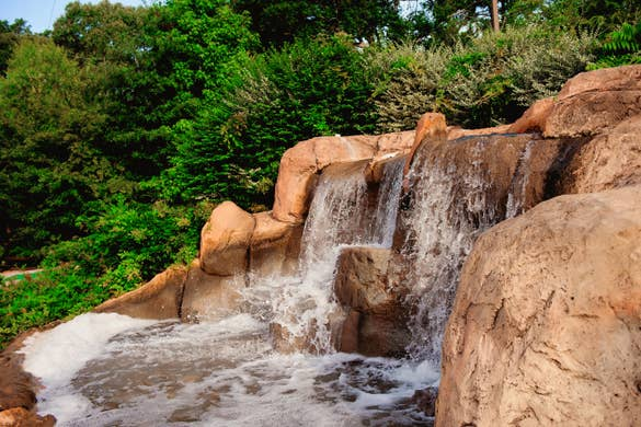 A waterfall feature and various putting greens at our mini golf course at Villages Resort in Flint, Texas.