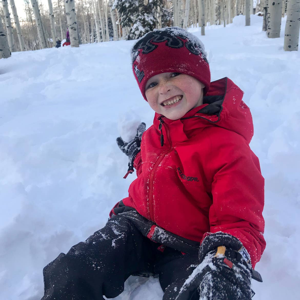 Contributor, Jessica Averett's son clad in winter gear playing in the snow.