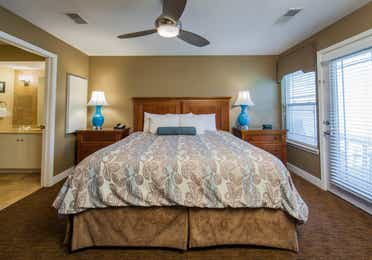 Bedroom in a two-bedroom ambassador villa at the Holiday Hills Resort in Branson Missouri.