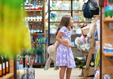 Young girl looking through toys at Marketplace at Orange Lake Resort near Orlando, Florida