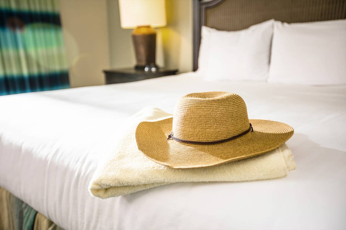 A straw sunhat places in the master bedroom in our villa at South Beach Resort in Myrtle Beach, SC.