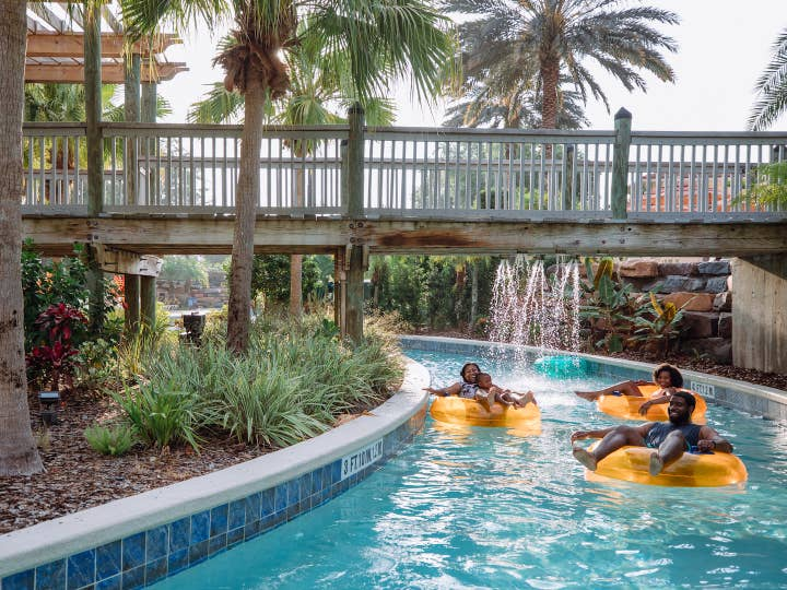 Three guests floating down lazy river at Orange Lake Resort near Orlando, Florida.