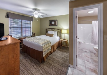 Bedroom with private bathroom in a three-bedroom ambassador villa at the Hill Country Resort in Canyon Lake, Texas.