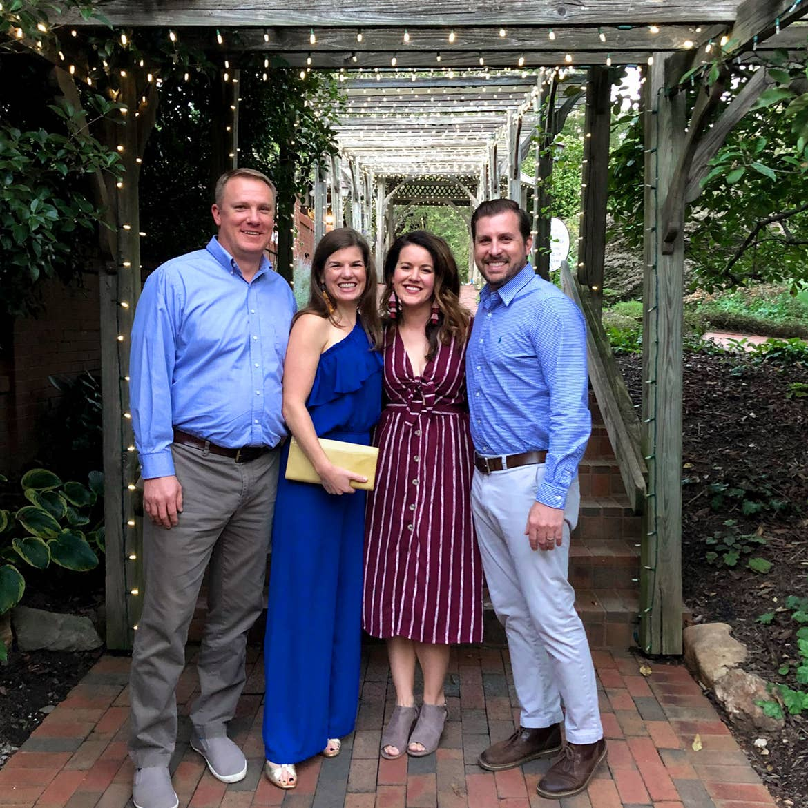 Author, Jenn C. Harmon (middle-right) and husband (right) stand with friends under the trellis of the gardens at the Biltmore Estate property near Antler Village Hall.