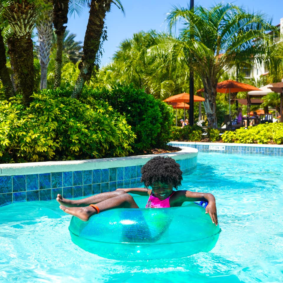 A young girl floats along our lazy river at Orange Lake Resort located in Orlando, FL.